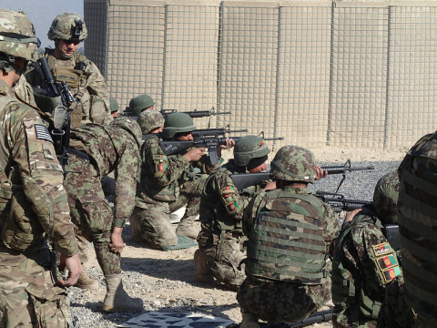 Members of Archangel Security Force Advisory and Assistance Team, 1st Squadron, 32nd Cavalry Regiment, 1st Brigade Combat Team, 101st Airborne Division look on as NCOs from 2nd Kandak, 4th BDE, 201st ANA Corps execute qualification on the M16 rifle on Shinwar Base in Nangahar Province. (Sgt. Connor Quinn/U.S. Army)