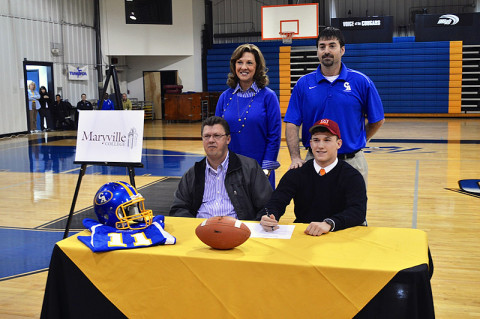 Clarksville Academy senior Nolan Blake, family, football coach Todd Hood and Head of School Kay Drew.