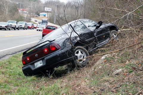A 2008 Chevy Impala runs off the road on the 41A-Bypass Monday. (Photo by CPD-Jim Knoll)