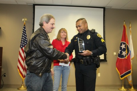 Tommy and Mary Bowles congratulating Sgt. Johnny Ferguson after he received the award for saving his Tommy Bowles' life.