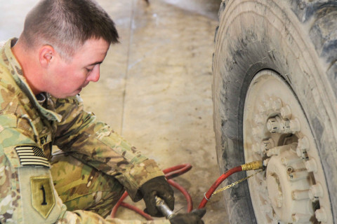 "A Soldier assigned to 1st Battalion, 187th Infantry Regiment, 3rd Brigade Combat Team ""Rakkasans,"" 101st Airborne Division (Air Assault), checks and refills air into a tactical vehicle on Forward Operating Base Gardez, Afghanistan, Jan. 24, 2013. The vehicle recovery team may be called out at a moment's notice and vehicle readiness is a major requirement. (Spc. Brian Smith-Dutton/U.S. Army"