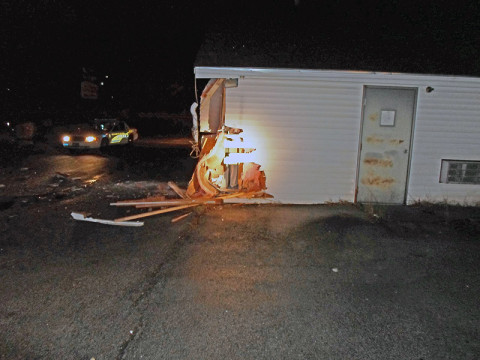 Golden Thimble Tailor Shop was backed into by Nissan Altima causing damage to the building. (Photo by CPD Sgt Greg Beebe)