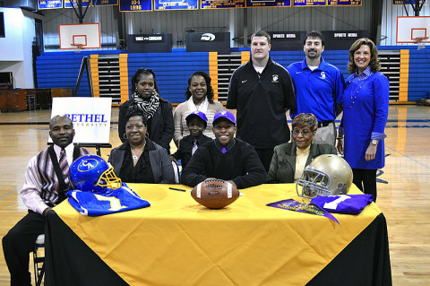 Clarksville Academy senior Ron Washington, family, football coach Todd Hood and Head of School Kay Drew.