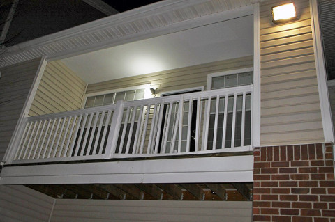The balcony from which two people jumped to avoid the gun fire. (Photo by CPD)