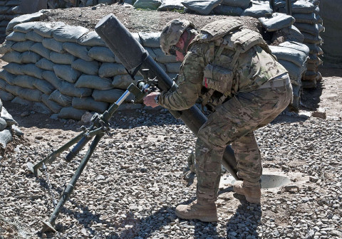 """U.S. Army Spc. Donavan Dauzat, a mortarman with Company C, 3rd Battalion, 187th Infantry Regiment, 3rd Brigade """"Rakkasans,"""" 101st Airborne Division (Air Assault), adjusts a 120 mm mortar tube during a training exercise, March 1, 2013, at Combat Outpost Bowri Tana. The mortar section trains daily for fire missions. (U.S. Army Photo by Spc. Alex Kirk Amen, 115th Mobile Public Affairs Detachment)"""