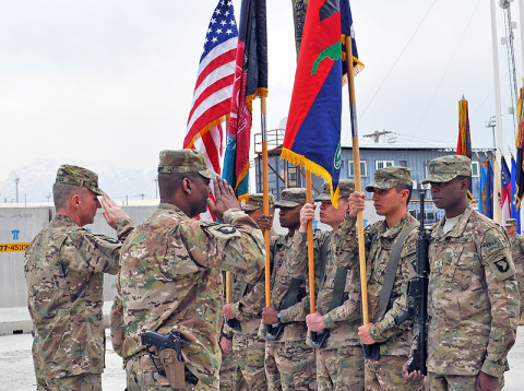 U.S. Army Maj. Gen. James C. McConville and U.S. Army Command Sgt. Maj. Alonzo J. Smith (forefront), the command team of 101st Airborne Division (Air Assault) and Combined Joint Task Force-101, salute the unit's flag at a transfer of authority ceremony at Bagram Air Field, Afghanistan, March 14th, 2013. The 101st Airborne Division assumed responsibility of Regional Command-East from the 1st Infantry Division. (U.S. Army photo by Staff Sgt. David J. Overson, 115th Mobile Public Affairs Detachment)