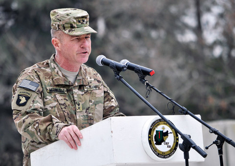 U.S. Army Maj. Gen. James C. McConville, commander of the 101st Airborne Division (Air Assault) and Combined Joint Task Force-101, addresses the audience at a transfer of authority ceremony at Bagram Air Field, Afghanistan, March 14, 2013. The 101st Airborne Division (Air Assault) assumed responsibility of Regional Command-East from the 1st Infantry Division. (U.S. Army photo by Staff Sgt. David J. Overson, 115th Mobile Public Affairs Detachment)