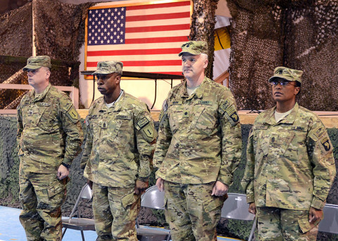 (Left-to-right) U.S. Army Col. James Davis and Command Sgt. Maj. Maurice Chaplin, Division Headquarters and Headquarters Battalion, 1st Infantry Division command team, along with Lt. Col. Scott Noon and Command Sgt. Maj. Tonika Scott-Morris, Division Headquarters and Headquarters Battalion, 101st Airborne Division (Air Assault) participate in a battalion casing and uncasing ceremony, respectively, Feb. 28, 2013, at Bagram Airfield. (U.S. Army photo by Sgt. 1st Class Kevin Hartman, 115th Mobile Public Affairs Detachment)