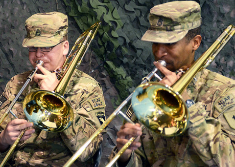 U.S. Army Staff Sgt. Vincent Lawyer (left), a trombone player with the 101st Airborne Division (Air Assault) Band, and Sgt. 1st Class David McDonald, also a trombone player with the 1st Infantry Division Band, perform during the casing ceremony for the division headquarters battalion of the 1st Infantry Division and the uncasing ceremony for the division headquarters battalion for the incoming 101st Airborne Division (Air Assault), Feb. 28, 2013, at Bagram Airfield, Afghanistan. (U.S. Army photo by Sgt. 1st Class Kevin Hartman, 115th Mobile Public Affairs)