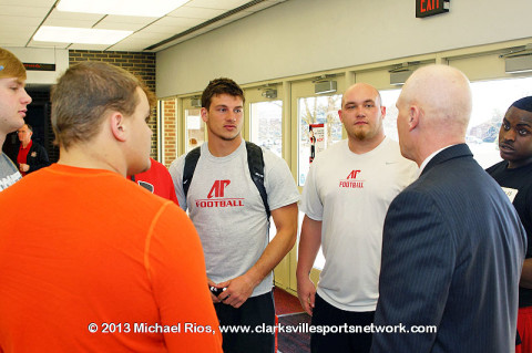 APSU Coach Kirby Cannon talking to some APSU Football Players.