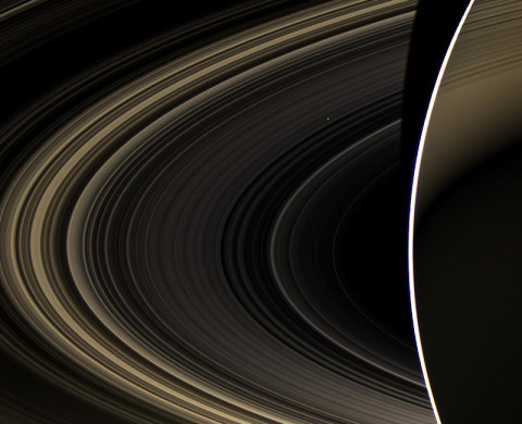 Peering over the shoulder of giant Saturn, through its rings, and across interplanetary space, NASA's Cassini spacecraft spies the bright, cloudy terrestrial planet, Venus. The vast distance from Saturn means that Venus only shows up as a white dot, just above and to the right of the image center. (Image credit: NASA/JPL-Caltech/Space Science Institute)