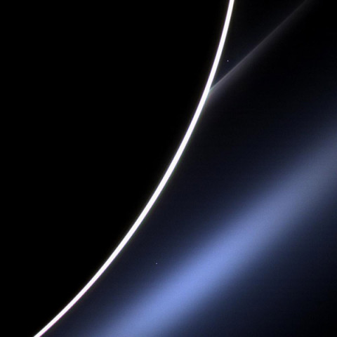 Dawn on Saturn is greeted across the vastness of interplanetary space by the morning star, Venus, in this image from NASA's Cassini spacecraft. Venus appears just off the edge of the planet, in the upper part of the image, directly above the white streak of Saturn's G ring. Lower down, Saturn's E ring makes an appearance, looking blue thanks to the scattering properties of the dust that comprises the ring. A bright spot near the E ring is a distant star. (Image Credit: NASA/JPL-Caltech/Space Science Institute)