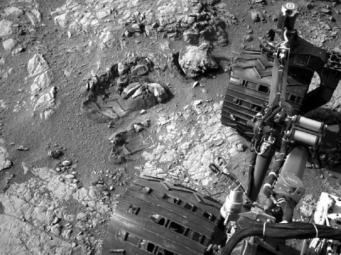 "This view of Curiosity's left-front and left-center wheels and of marks made by wheels on the ground in the ""Yellowknife Bay"" area comes from one of six cameras used on Mars for the first time more than six months after the rover landed. The left Navigation Camera (Navcam) linked to Curiosity's B-side computer took this image during the 223rd Martian day, or sol, of Curiosity's work on Mars (March 22, 2013). The wheels are 20 inches (50 centimeters) in diameter. (Image credit: NASA/JPL-Caltech)"