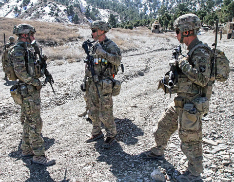 "Soldiers assigned to Blue Platoon, Troop B, 1st Squadron, 33rd Cavalry Regiment, 3rd Brigade Combat Team ""Rakkasans,"" 101st Airborne Division (Air Assault), discuss possible movement routes through the mountainous terrain before a patrol in Musa Khel District, Afghanistan, March 6, 2013. Soldiers conducted a 12-mile dismounted patrol in order to reach a village in the valley that is inaccessible by vehicle. (U.S. Army Photo by Spc. Brian Smith-Dutton TF 3/101 Public Affairs)"