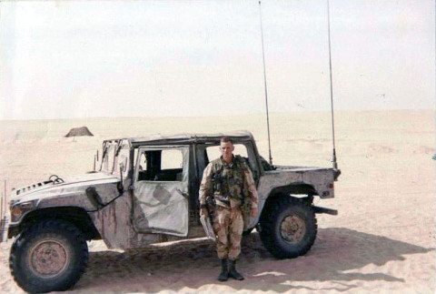 "IRAQ – Robert Fay Sr., an infantryman assigned to Company A, 3rd Battalion, 187th Infantry Regiment, 3rd Brigade Combat Team ""Rakkasans,"" 101st Airborne Division (Air Assault), stands near his Humvee in the desert near Iraq during the Gulf War. Fay Jr. was born and named just after his father was deployed. (courtesy photo)"