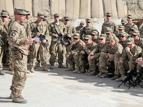 """U.S. Army Lt. Col. Donald Evans, squadron commander for 1st Squadron, 33rd Cavalry Regiment, 3rd Brigade Combat Team """"Rakkasans,"""" 101st Airborne Division (Air Assault), gives a quarterly update to his squadron about success so far while deployed at Camp Clark, Afghanistan, March 4, 2013. Evans stressed to the troops to stay vigilant. (U.S. Army photo by Spc. Brian Smith-Dutton TF 3/101 Public Affairs)"""