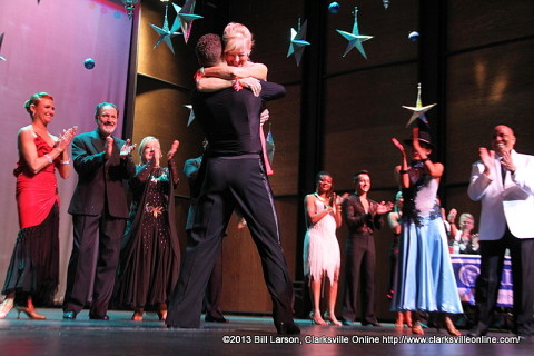 Mary Cooper hugs Jonathan Bungard, her pro partner after winning Altrusa's 2013 Dancing with the Stars