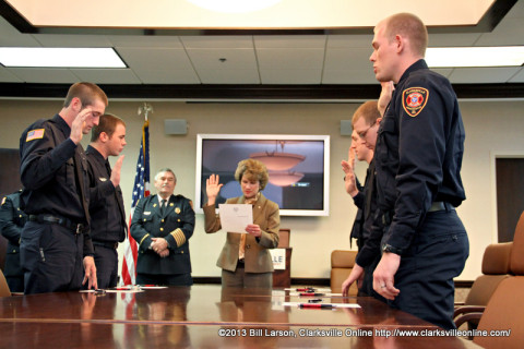 Clarksville Mayor Kim McMillan swears in five new firefighters at the Clarksville City Hall on Friday