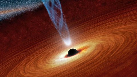 This artist's concept illustrates a supermassive black hole with millions to billions times the mass of our sun. Supermassive black holes are enormously dense objects buried at the hearts of galaxies. (Image credit: NASA/JPL-Caltech)