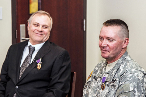 Staff Sgt. Richard McLain, (right) and Sgt. Donnie Roach take questions from the media following their Purple Heart Award Ceremony at Fort Campbell. Roach, a Vietnam Veteran, received his award more than 40 years after being wounded in the Vietnam War (Photo by Sgt. Joe Padula)