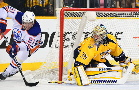 Nashville Predators goalie Pekka Rinne (35) defends the goal against Edmonton Oilers left wing Magnus Paajarvi (91) during the second period at Bridgestone Arena March 8th. (Photo by Don McPeak - USA TODAY Sports)