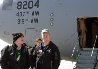 Retired Major League Baseball pitcher Curt Schilling (left) and Denver Broncos' quarterback Peyton Manning arrive at Bagram Airfield, Afghanistan, to entertain the troops with a USO tour March 1st, 2013.(U.S. Army photo by Staff Sgt. David J. Overson 115th Mobile Public Affairs Detachment)