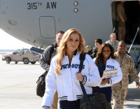 Dallas Cowboys Cheerleaders Cassie Trammell (front) and Jackie Bob, along with Peyton Manning, Curt Schilling, Austin Collie and Vincent Jackson arrive at Bagram Airfield, Afghanistan, to entertain the troops with a USO tour March 1st, 2013. (U.S. Army photo by Staff Sgt. David J. Overson 115th Mobile Public Affairs Detachment)