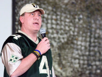 Retired MLB pitcher Curt Schilling addresses the troops at Bagram Airfield, Afghanistan, with a USO tour. Along with Schilling was Peyton Manning, NFL players Austin Collie and Vincent Jackson, March 1st, 2013. (U.S. Army photo by Staff Sgt. David J. Overson 115th Mobile Public Affairs Detachment)