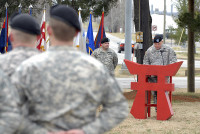 """Maj. John Page, Rear-Detachment commander of the 3rd Brigade Combat Team """"Rakkasans,"""" 101st Airborne Division (Air Assault), speaks about the long and valorous history of the 187th Infantry Regiment during an activation ceremony Feb. 20 at Fort Campbell, Ky. All of the fallen Rakkasans, whose names are inscribed on the pylons that stand in front of them. (U.S. Army photo taken by Sgt. Alan Graziano, 3rd Brigade Combat Team, 101st Airborne Division)"""
