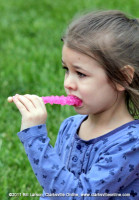 A young girl enjoys a tasty treat at the Rivers and Spires Festival