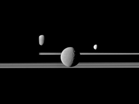The Cassini spacecraft observes three of Saturn's moons set against the darkened night side of the planet. (Image Credit: NASA/JPL/Space Science Institute)