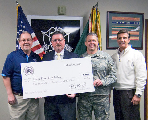 "Members of the Special Forces Association receive a heartfelt donation from the Tennessee Titans Community Relations staff. Bob Hyde, Titans Vice President of Community Relations, and Jerry Blessing, Titans Community Relations Event Coordinator, on behalf of Titans Owner K.S. ""Bud"" Adams, Jr. (Photo by Staff Sgt. Barbara Ospina, 5th Special Forces Group (Airborne) Public Affairs)"