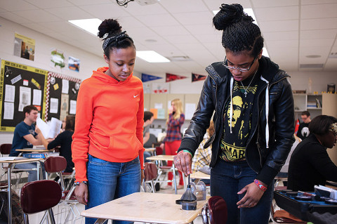 West Creek High School will offer the Academy of Criminal Justice and Homeland Security.  Current students Alexis Crawley (left) and Tia Childs practice fingerprinting techniques.