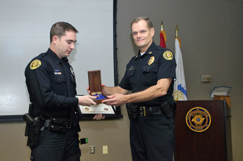 Clarksville Police Officer Seth Paugh (left) receives Lifesaver Award from  Chief Al Ansley (right), Friday, March 8th, 2013. (Photo by CPD-Jim Knoll)
