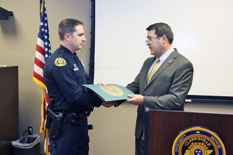 Clarksville Police Officer Seth Paugh is presented with a Senate Joint Resolution by Senator Mark Green