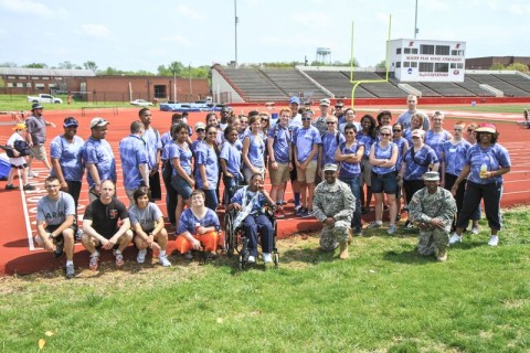 The volunteer Soldiers from the 526th Brigade Support Battalion, 2nd Brigade Combat Team, 101st Airborne Division (Air Assault) and the Fort Campbell High School student athletes and coaches, pose for a picture after the closing ceremonies of the Area 12 Special Olympics held at Clarksville's Austin Peay Stadium, April 18.(US Army photo by Sgt. Keith Rogers, 2nd BCT UPAR, 101st Abn. Div.)