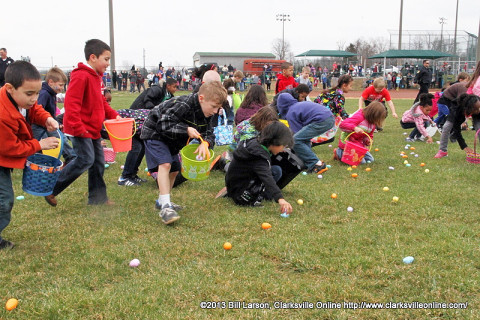 Kids scoop up Easter Eggs during the City of Clarksville's 2013 Spring Eggstravanganza Easter Egg Hunt
