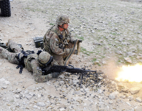 U.S. Army Spc. Sean Michaels, a motor transport operator with Company A, 426th Brigade Support Battalion, 1st Brigade Combat Team, 101st Airborne Division, and native to Horseheads, N.Y., fires the MK-48 machine gun March 20 at a range outside Forward Operating Base Mehtar Lam, Afghanistan. (U.S. Army photo by Sgt. Jon Heinrich, CT 1-101 Public Affairs)