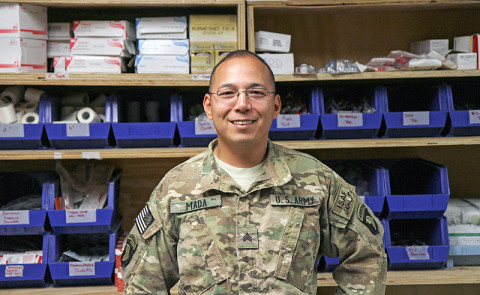 "Army Sgt. Luciano Mada, a medic assigned to Headquarters, Headquarters Company, 3rd Battalion, 187th Infantry Regiment, 3rd Brigade Combat Team ""Rakkasans,"" 101st Airborne Division (Air Assault), poses for a photo at the medical center at Forward Operating Base Salerno, Afghanistan, April 10, 2013. Mada spent his deployment training Afghan National Security Forces to become medics for their units. (U.S. Army Photo by Spc. Brian Smith-Dutton TF 3/101 Public Affairs)"