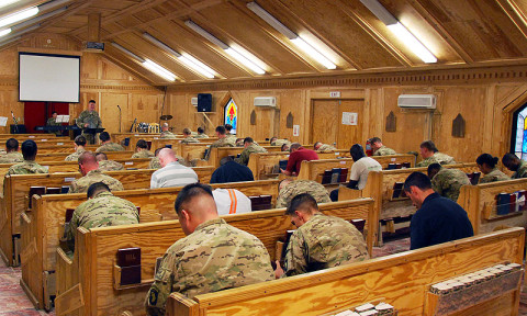 U.S. Army Capt. Erik Alfsen, chaplain, 3rd Battalion, 187th Infantry Regiment, 3rd Brigade Combat Team, 101st Airborne Division (Air Assault), delivers the benediction to parishioners praying during Easter Sunday at Chapel Next at Forward Operating Base Salerno, Afghanistan, March, 31st, 2013. (Courtesy photo)