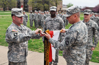 Command Sgt. Maj. Brandon Haywood, command sergeant major of the 2nd Brigade Combat Team, 101st Airborne Division (left), and 101st Airborne Division Senior Acting Commander, Brig. Gen. Mark Stammer, add the coveted Gold Air Assault Excellence Streamer to the Apache Troop, 1st Squadron, 75th Cavalry Regiment, 2nd Brigade Combat Team, 101st Airborne Division (Air Assault) guidon during a special ceremony conducted at Strike Field. (Photo by Master Sgt. Pete Mayes, 101st Airborne Division Public Affairs Office)