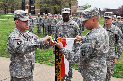 Command Sgt. Maj. Brandon Haywood, command sergeant major of the 2nd Brigade Combat Team, 101st Airborne Division (left), and 101st Airborne Division Senior Acting Commander, Brig. Gen. Mark Stammer, add the coveted Gold Air Assault Excellence Streamer to the Apache Troop, 1st Squadron, 75th Cavalry Regiment, 2nd Brigade Combat Team, 101st Airborne Division (Air Assault) guidon during a special ceremony conducted at Strike Field Tuesday. (Photo by Master Sgt. Pete Mayes, 101st Airborne Division Public Affairs Office)