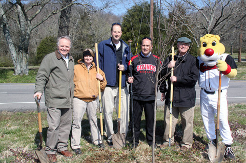 "Tennessee Wildlife Resources Agency and Nashville Sounds were among those planting trees in Edwin Warner Park as part of the ""Swing for the Trees"" program. From left; Don King (TWRA Information and Education Division Chief), Pandy English (Instream Flow Coordinator, TWRA Environmental Services), Doug Scopel (Sounds Assistant General Manager), Brad Tammen (Sounds Vice President/General Manager) Steve Patrick (TWRA Assistant Director), and Ozzie (Sounds mascot)."