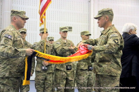4th Brigade Combat Team Commander Colonel Valery C. Keaveny, Jr. and Command Sgt. Maj. Michael A. Grinston prepare the Brigade Flag for casing in preparation for unit's upcoming deployment to Afghanistan
