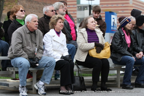 Clarksville Mayor Kim McMillan and City Councilman Geno Grubbs watches the Beatles cover band Yesterday perform from the bleachers at the Public Square Stage
