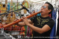 A Native American Flutist plays at the 2013 Rivers and Spires Festival