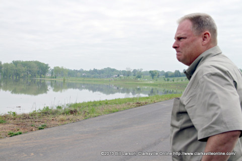 Mark Tummons the Director of the Clarksville Department of Parks and Recreation surveys the flooded Liberty Park