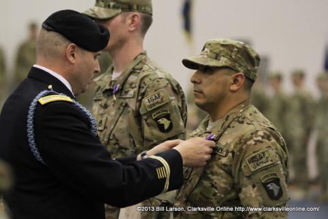 Colonel Valery C. Keaveny, Jr. pins a Purple Heart on Sgt. Matthew Guess