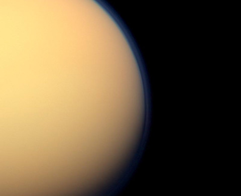 The recently formed south polar vortex stands out in the color-swaddled atmosphere of Saturn's largest moon, Titan, in this natural color view from NASA's Cassini spacecraft. (Image credit: NASA/JPL-Caltech/Space Science Institute)