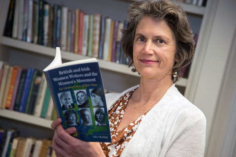 """Dr. Jill Franks, APSU professor of English, reads through her new book, """"British and Irish Women Writers and the Women's Movement: Six Literary Voices of Their Times."""" (Photo by Beth Liggett/APSU staff)"""